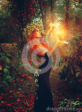 Fantasy photo of young redhair lady wizard Stock Photo