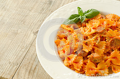 Farfalle topped with tomato sauce and meat