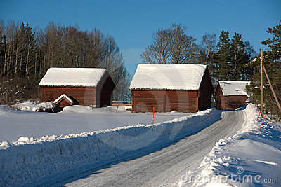 Farm buildings covered in snow