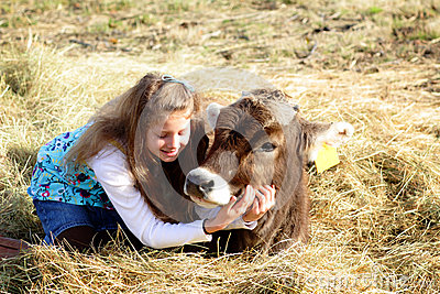 Farm girl and pet cow