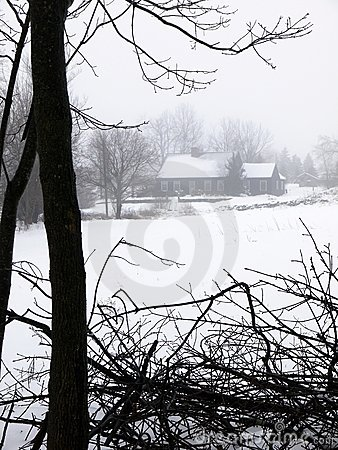 Farm: house in fog and snow
