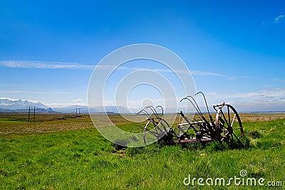 Farm land with rusty farming equipment