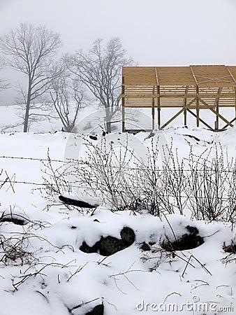 Farm: new barn construction winter fog