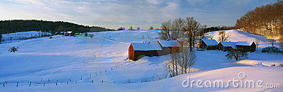 Farm in New England covered in snow