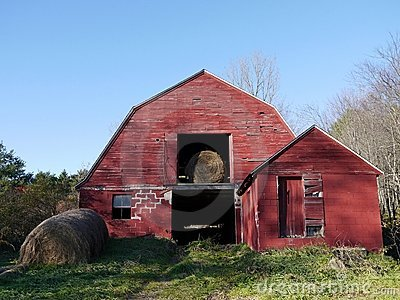 Farm: old red barn with hay bales