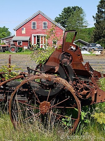 Farm: red barn with old machinery