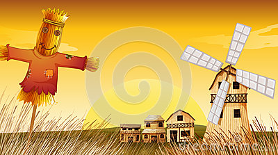 A farm with a scarecrow and a windmill
