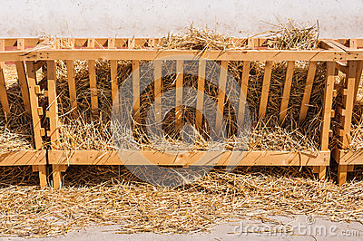 Farm stall with straw and hay