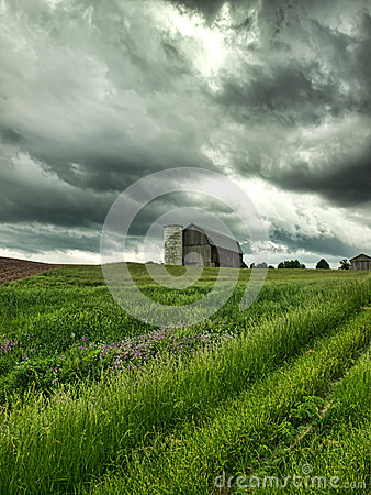 Farm and threatening stormy sky