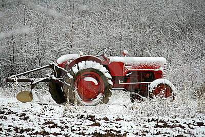 Farm Tractor  in Early Snow