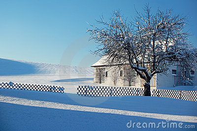 Farm in Winter Landscape