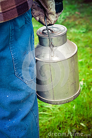 Free Farmer Carrying A Vintage Dairy Milk Can. Royalty Free Stock Images - 54269179