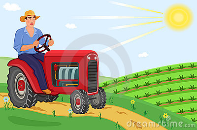 Farmer driving his tractor on the fields