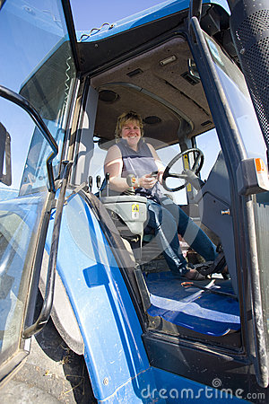 Free Farmer Driving Tractor Stock Images - 41717584
