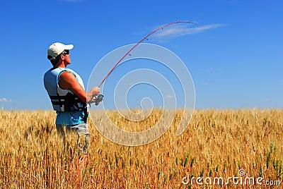 Farmer fishing for wheat