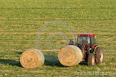 Farmer and hay bales