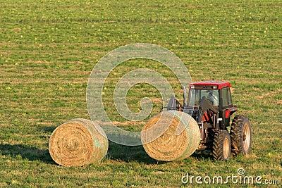 Farmer and hay bales
