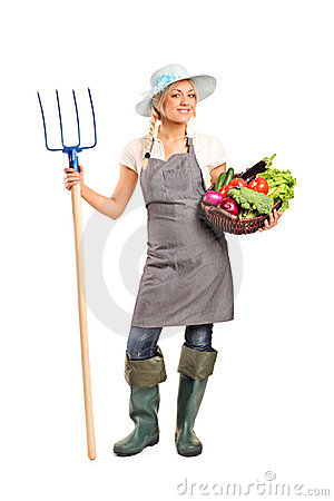 Free Farmer Holding A Pitchfork And Vegetables Stock Photography - 20449572