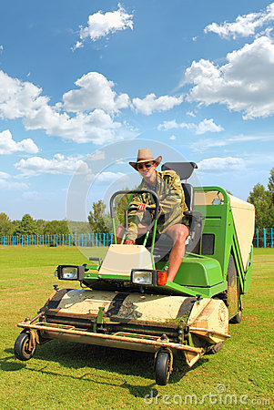 Free Farmer Mowing The Lawn Stock Image - 54706381