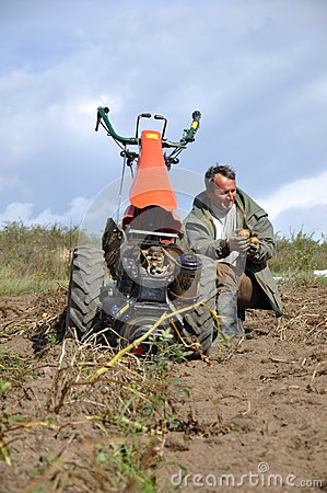 Farmer plowing the ground