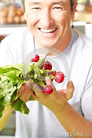 Farmer with radish in farm shop