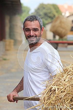 Free Farmer Removing Hay Royalty Free Stock Photo - 32234875