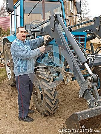 Farmer repairing tractor 2
