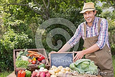 Farmer selling organic veg at market Stock Photo