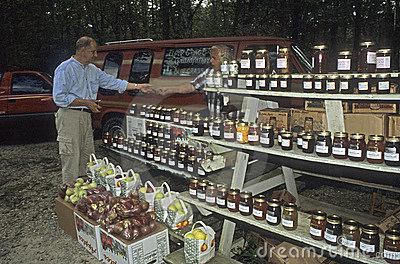 Farmer selling at roadside stand Editorial Stock Image