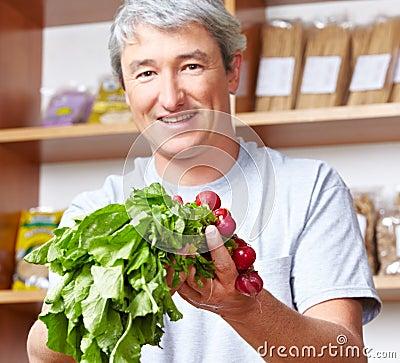 Farmer selling vegetables in farm