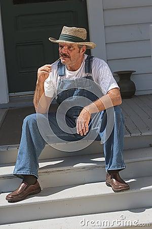 Farmer Sitting On Porch Smoking A Pipe Stock Photos