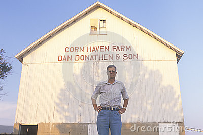 Farmer standing in front of corn barn Editorial Image