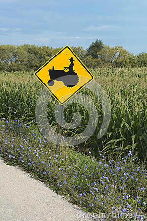 Farmer on Tractor Road Waring Sign