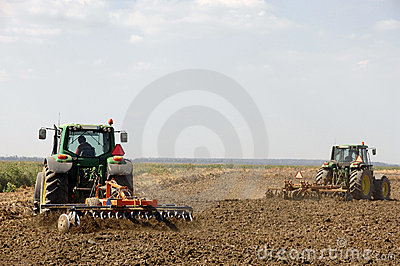 Farmers plowing with tractor Editorial Photography