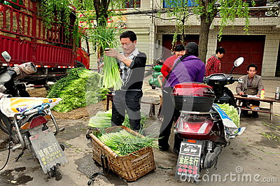 Pengzhou, China: Farmers Weighing Garlic Greens Editorial Image