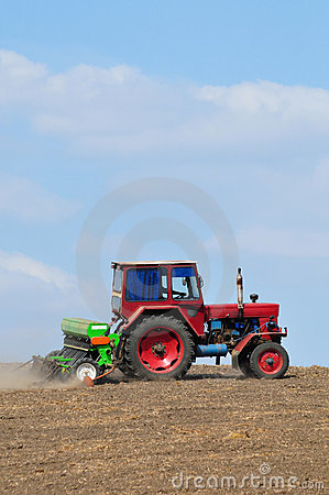 Farming tractor plowing
