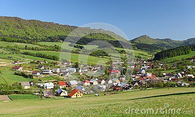Farmland, small town and forested hills.