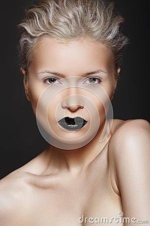 Fashion beauty. Hairstyle, make-up & black lips