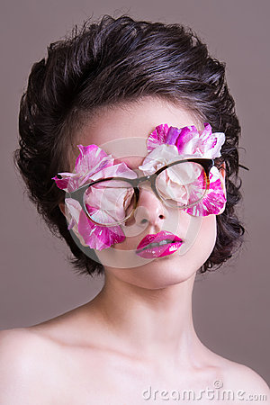 Free Fashion Beauty Model Girl Wearing Stylish Glasses Full Of Rose Petals. Creative Makeup And Hairstyle. Royalty Free Stock Image - 95890586