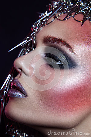 Free Fashion Beauty Model With Metallic Headwear And Shiny Silver Red Makeup And Blue Eyes And Red Eyebrows On Black Background Stock Photos - 84825063