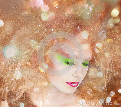 Fashion beauty woman with colorful makeup and creative hairstyle