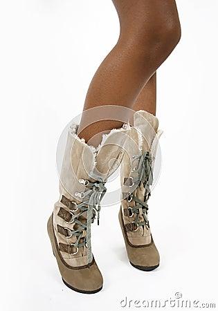 Fashion beige fur women s boots on a sexy legs