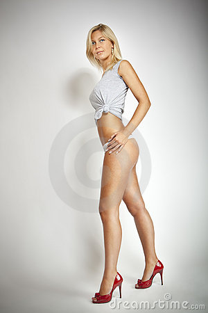 Fashion blond girl with long feet