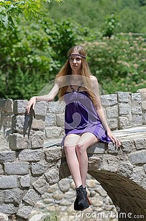 Free Fashion Blonde With Short Dress Sitting On Small Stone Bridge Stock Photos - 62362823