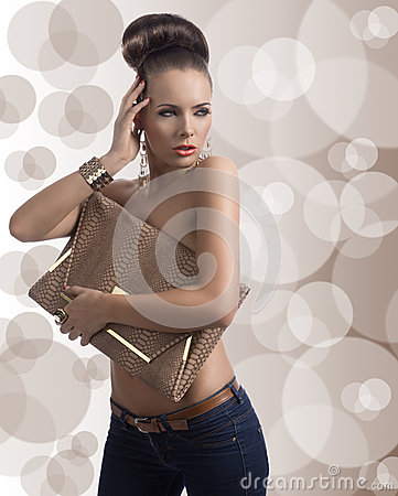 Free Fashion Brunette In Jeans With Big Bag And Hand Near The Head Stock Images - 29560864