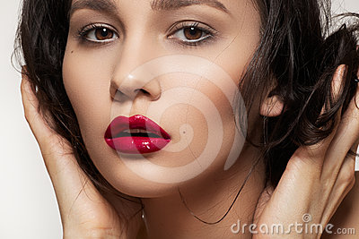 Fashion brunette with sexy lip make-up, clean skin