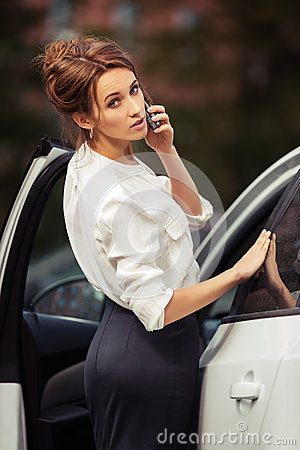 Free Fashion Business Woman Calling On Mobile Phone Beside A Car Royalty Free Stock Photography - 67655287