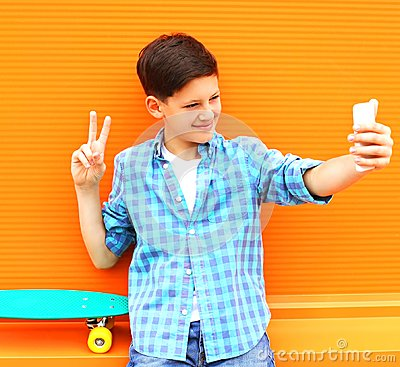 Free Fashion Cool Teenager Boy Is Taking Picture Self Portrait Royalty Free Stock Photo - 122022275