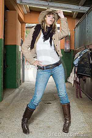 Fashion cow girl in an stable
