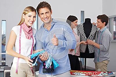 Fashion design student holding